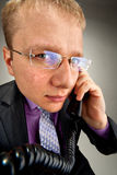 Bizarre businessman talking by phone Royalty Free Stock Images