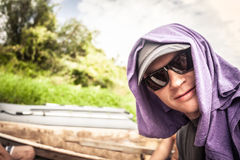 Bizarre cheerful smiling young man in sunglasses outdoors portrait Stock Image