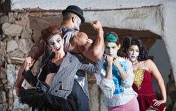 Bizarre Cirque Performance. Bizarre comedia del arte performance ensemble outdoors Stock Photos