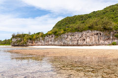 Bizarre cliff beach. Bizarre cliff in Ritidian beach, Guam royalty free stock images