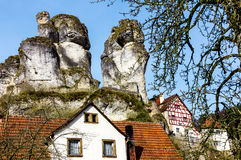 Bizarre columns of rocks Franconian Switzerland Germany. Bizarre columns of rocks (limestone), half-timbered houses Stock Image