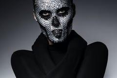 Bizarre creative woman with skull. In studio Stock Photos