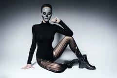 Bizarre dark woman in black clothing. In studio Royalty Free Stock Image