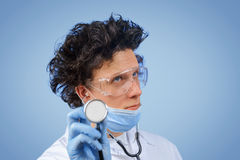 Bizarre doctor listens with stethoscope Stock Photo