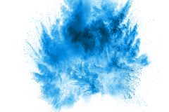 Bizarre forms of blue powder explode cloud on white background. Launched blue dust particles splashing.  royalty free stock photo