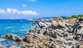 Bizarre granite rocks and amazing azure water on beautiful Sardinia island near Porto Pollo, Sargedna, Italy Stock Image