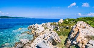 Bizarre granite rocks and amazing azure water on beautiful Sardinia island near Porto Pollo, Sargedna, Italy Royalty Free Stock Photos
