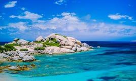 Bizarre granite rocks formation in amazing azure water on beautiful Sardinia island near Porto Pollo, Sargedna, Italy Royalty Free Stock Photo