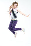 Bizarre jumping girl. Bizarre jumping teenage trendy girl studio shot Stock Photo