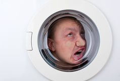 Bizarre man inside washing machine Stock Photo