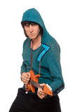 Bizarre man with a little guitar. Isolated stock photo