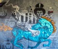 Bizarre mural. Beautiful, strange graffiti on a winery wall Stock Images