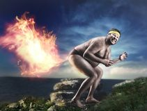 Bizarre naked man farts flame. At night Royalty Free Stock Images