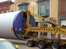 Bizarre oversize truck load. Oversize Load Trailer Truck going through town Stock Photo