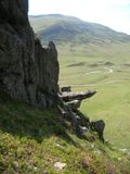Bizarre rock face and Green Hills at Glenshee Valley, Grampian Mountains, Scotland. Scenic view at Glen Shee Valley. Location: alongside the Old Military Road Royalty Free Stock Photography