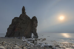Bizarre rock formations on the beach in winter. Royalty Free Stock Image