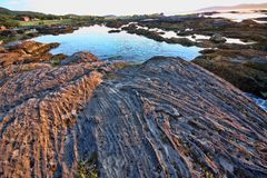 Bizarre rocks drained by the sea, Norway. The Bizarre rocks drained by the sea, Norway Royalty Free Stock Image