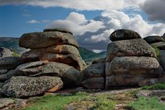Bizarre rocks in the middle of the vast steppes of Kazakhstan. East Kazakhstan. The uniqueness of Bayanaul in the fact that mountains surrounded on all sides by Royalty Free Stock Photos
