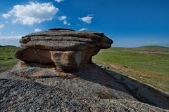 Bizarre rocks in the middle of the vast steppes of Kazakhstan. East Kazakhstan. The uniqueness of Bayanaul in the fact that mountains surrounded on all sides by Stock Photo