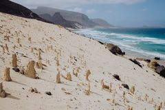 Bizarre sandstone formations in the lunar landscape on the coastline of Sao Vicente Island Cape Verde.  Royalty Free Stock Images