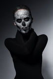 Bizarre scary woman with skull. In studio Royalty Free Stock Photo
