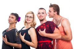 Bizarre three men cross-dressing and one woman. Group of bizarre three men cross-dressing and one women holding breasts, isolated on white background Royalty Free Stock Image