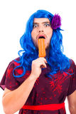 Bizarre transvestite with ice pop. Bizarre transvestite licking ice pop, isolated on white background royalty free stock photography