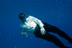 Bizarre underwater men Royalty Free Stock Photo