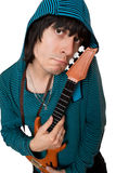 Bizarre young man with a little guitar. Isolated. On white Stock Photography