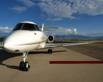 Bizjet red carpet. Rolled out red carpet up to a private jet aircraft door Royalty Free Stock Images