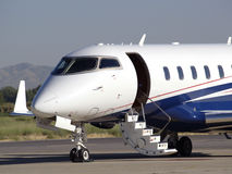 Bizjet stairs. Business jet with stair extended for loading and unloading of passengers Stock Images