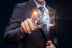 Biznesmenów dotyki atom Zdjęcie Royalty Free