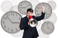 Biznesmenów stojaki wśród zegarów Zdjęcia Royalty Free