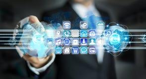 Biznesmenów złączeni światy ikony i zastosowania oprogramowanie Obraz Royalty Free