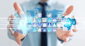 Biznesmenów złączeni światy ikony i zastosowania oprogramowanie Zdjęcie Stock