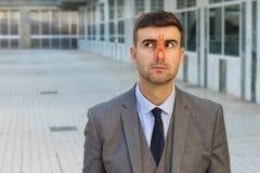 Biznesmen blokuje jego z clothespin nos obraz royalty free