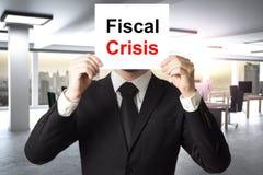 Biznesmen chuje twarz za szyldowym fiskalnym kryzysem Fotografia Stock