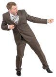 Biznesmen ciągnie niewidzialną arkanę zdjęcie stock
