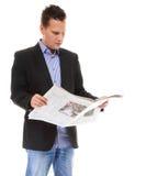 Biznesmen czyta gazetę odizolowywającą Zdjęcia Stock
