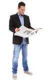 Biznesmen czyta gazetę odizolowywającą Obrazy Stock