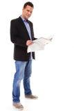 Biznesmen czyta gazetę odizolowywającą Obraz Stock