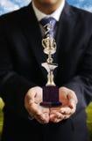 Biznesmen daje piłki nożnej trofeum, Sccess Fotografia Royalty Free