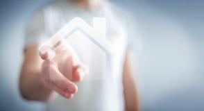 Biznesmen dotyka 3D renderingu ikony dom z jego palcem Obrazy Stock