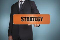 Biznesmen dotyka słowo strategię Zdjęcia Stock