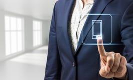 Biznesmen dotyka wirtualną telefon ikonę Fotografia Stock