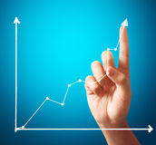Biznesmen Dotyka wykres Fotografia Stock