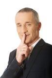 Biznesmen gestykuluje cichego znaka Zdjęcie Royalty Free