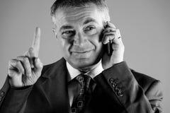 Biznesmen gestykuluje z jego palcem zdjęcia royalty free