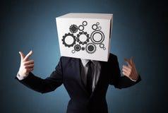 Biznesmen gestykuluje z kartonem na jego głowie z ostroga zdjęcia stock