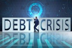 Biznesmen gniosący między kryzysem i długiem zdjęcie royalty free